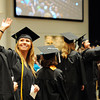 Early Childhood Education graduate, Jessica M. Skeens, waves to her family after entering the Northside Christian Church auditorium for Ivy Tech's 2014 graduation ceremony Tuesday.<br /> Staff photo by Tyler Stewart