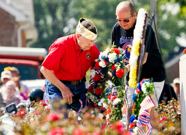 World War II veteran Dick Durlauf, New Albany, left, places a wreath for Veterans of Foreign Wars Post 1693 during the annual Memorial Day service at Veterans Plaza in New Albany on Monday morning. Staff photo by Christopher Fryer