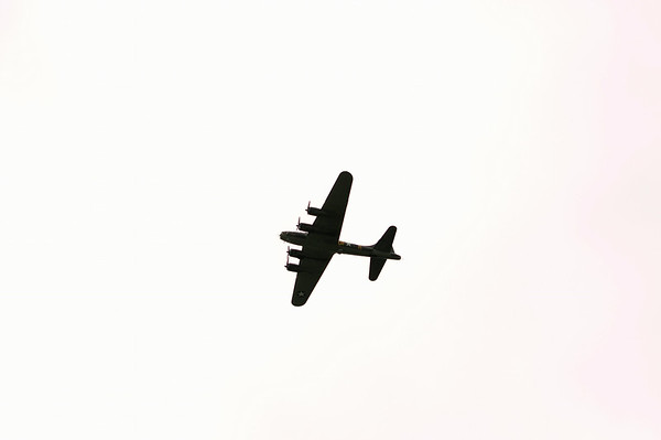 "A B-17 bomber flies above the Clark County Airport as part of The Liberty Foundation's 2014 Salute to Veterans tour. The plane, which dates back to 1945, was used in the 1990 film ""Memphis Belle"", and is one of only 12 B-17 bombers in the world that are still able to fly. Staff photo by Christopher Fryer"