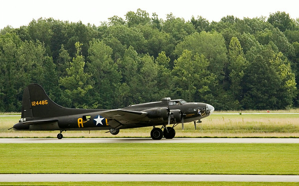 "A B-17 bomber lands at the Clark County Airport as part of The Liberty Foundation's 2014 Salute to Veterans tour. The plane, which dates back to 1945, was used in the 1990 film ""Memphis Belle"", and is one of only 12 B-17 bombers in the world that are still able to fly. Staff photo by Christopher Fryer"
