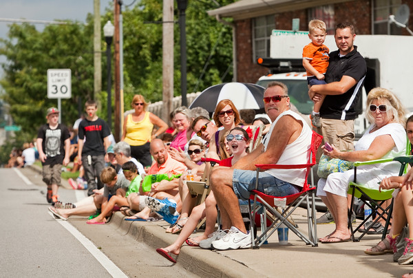Attendees look on as the ClarkFEST parade moves along Eastern Boulevard in Clarksville on Monday morning. Staff photo by Christopher Fryer