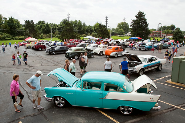Festival attendees look at vehicles on display in the car show during ClarkFEST in Clarksville on Monday afternoon. Staff photo by Christopher Fryer