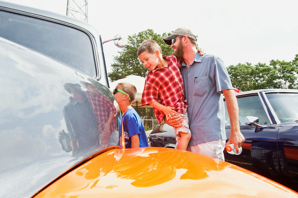 Joe Morgan, Floyds Knobs, gives his son Silas, 5, a lift while they look at a 1952 Chevrolet truck during ClarkFEST in Clarksville on Monday afternoon. Staff photo by Christopher Fryer