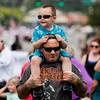 Ken James Norton, Clarksville, holds his son, Ken Bryant Norton, 4, on his shoulders while they watch the ClarkFEST parade move along Eastern Boulevard in Clarksville on Monday afternoon. Staff photo by Christopher Fryer