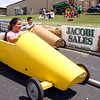 Victoria Gil and her brother, Gabriel, race in soapbox cars at the St. John Starlight Strawberry Festival. Children had a variety of activities available to them. Staff photo by Jerod Clapp