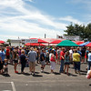Crowds of people wait in line for any of the food and desserts available at the St. John's Starlight Strawberry Festival on Saturday. Damon Andres, festival committee chair, said they never expect 10,000 people, but he thought they'd make that number by day's end. Staff photo by Jerod Clapp