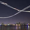 A slow exposure shows a plane's course during over the Ohio River just before the 25th Annual Thunder Over Louisville Saturday night.<br /> Staff photo by Tyler Stewart