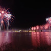A view from Kingfish in Jeffersonville shows the fireworks erupt over the Ohio River during the 25th Annual Thunder Over Louisville Saturday night.<br /> Staff photo by Tyler Stewart