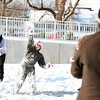Isabella Rodriquez, 9, launches a snowball toward Steve Skippler, Jeffersonville, at Big Four Station in Jeffersonville on Tuesday. A handful of Jeffersonville residents answered the call for a 4 p.m. impromptu snowball fight following the nearly 8 inches of snowfall in the area. <br /> Staff photo by Tyler Stewart