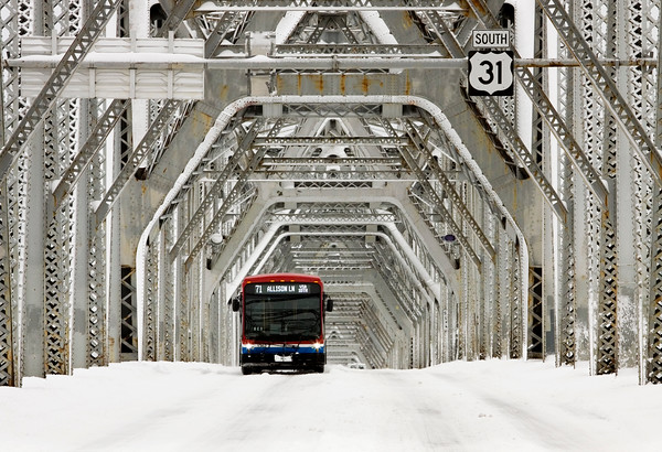 A Transit Authority of River City bus moves northbound into Indiana along the Clark Memorial Bridge on Thursday morning. According to the National Weather Service, Friday will be sunny, but temperatures will remain cold, with a high of around 23. Staff photo by Christopher Fryer
