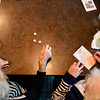 "Margaret Henninger, 88, throws the dice during a round of bunco as Norma Keller, 88, tallies numbers as part of the Bunco Club's monthly meeting at O'Charleys in Clarksville on Wednesday afternoon. The club, which has been meeting for nearly 58 years, keeps the focus on friendship and socialization. ""We've been friends since the first grade,"" said Keller about Henninger. ""She was even in my wedding."" Staff photo by Tyler Stewart"