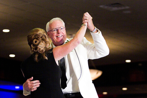 Mike Bennett, winner of the ninth annual Hosparus Southern Indiana United We Stand: Dancing With the Stars event, dances with Pam Martin during his routine at Huber's Orchard and Winery in Starlight on Tuesday night. About 860 people attended the charity event where $265,000 was raised. Staff photo by Christopher Fryer