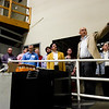 Rauch Industries Business Development Specialist Eric Geswein, far right, leads a group on a tour of the work floor prior to the Floyd County Commissioner and Council Candidate Forum at the New Albany non-profit Monday evening. Staff photo Christopher Fryer
