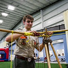 Eagle Scout David Dekold, 17, New Albany, works on the lashings for a cooking tripod at a mock campsite at Silver Street Park during a scouting open house in New Albany on Saturday afternoon. Staff photo by Christopher Fryer