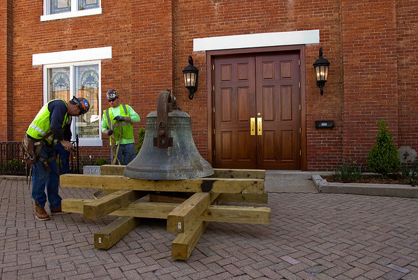 The Second Baptist Church bell is pictured in front of the historic church after it was temporarily removed from the clock tower Friday morning ahead of the installation of a new steeple that will take place next month. Staff photo by Christopher Fryer