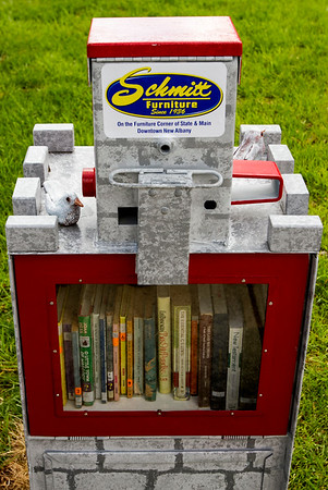 The first box of the Schmitt Furniture News Rack Little Free Library Project is pictured at St. Paul's Episcopal Church, 1015 Main St., in New Albany following a dedication ceremony Friday afternoon. Staff photo by Christopher Fryer