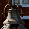 The Second Baptist Church bell is pictured in front of the historic church after it was temporarily removed from the clock tower Friday morning so prep work could be completed ahead of the installation of a new steeple that will take place next month. Staff photo by Christopher Fryer