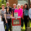 Participants in the Schmitt Furniture News Rack Little Free Library Project are pictured with the box located at St. Paul's Episcopal Church, 1015 Main St., in New Albany following a dedication ceremony Friday afternoon. Staff photo by Christopher Fryer