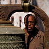Rev. LeRoy Marshall, Brooks, Ky., pastor at Second Baptist Church, studies the exterior of the church's bell after it was temporarily removed from the clock tower Friday morning so prep work could be done ahead of the installation of a new steeple that will take place next month. Staff photo by Christopher Fryer