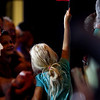 Kathryn Blair, Madison, waves an American flag in the air as she waits with her family for Ted Cruz to arrive prior to a rally for the presidential candidate in Starlight on Monday. Staff photo by Christopher Fryer