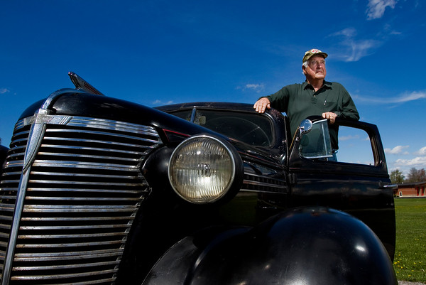 """Smitty"" Moyers, 78, is pictured with his 1938 Chevrolet Master at his New Albany home. Moyers will be driving the antique automobile in the The Great Race, a 2,200-mile endurance rally, this summer with his grandson as his navigator. Staff photo by Christopher Fryer"