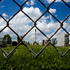 Gravestones are pictured through a chain link fence above a retaining wall that runs along the Culbertson Avenue perimeter of Fairview Cemetery. The New Albany Board of Public Works & Safety recently approved a replacement for the fence and repairs on the wall. Staff photo by Christopher Fryer