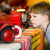 Gavin Wilson, 6, takes a closer look at a 1929 Kingsbury toy ladder truck during Snacks with Santa at the Vintage Fire Museum on Saturday. Staff Photo By Josh Hicks