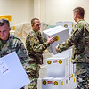 Soldiers of the Indiana National Guard in New Albany stack boxes of Christmas turkey meals for military families in Southern Indiana. Staff Photo By Josh Hicks