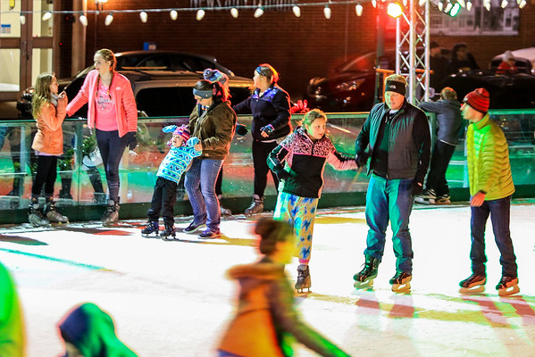 """Jeffersonville's Ice Rink draws a large crowd for their """"Teen Night"""" on Friday. Hours of operation: Monday-Thursday: 4-8 p.m., Friday: 4-10 p.m., Saturday: Noon-10 p.m., Sunday: Noon-8 p.m. Admission prices are as follows: $8 per person, $6 group rate (10 or more people), $2 discount if you bring your own skates, $40 for a season pass. For holiday break hours and special events, please visit  <a href=""""http://www.jeffmainstreet.org"""">http://www.jeffmainstreet.org</a>. Staff Photo By Josh Hicks"""