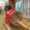 Ethan Henry, 15, a Life Scout and Senior Patrol Leader of Boy Scout Troop #25, bales a tree at Meyer Christmas Trees on Saturday. Troop #25 had a concession stand open on the side of the pictured barn, selling coffee, hot chocolate and snacks, like chili and chips. Staff Photo By Josh Hicks