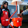 Salvation Army volunteer Danny Black, Jeffersonville, thanks a passerby for their donation while collecting money outside of Wal-Mart in Clarksville on Monday. Staff photo by Tyler Stewart