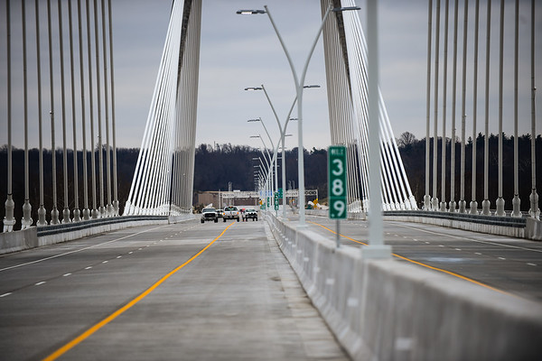 Construction crews make one of their last trips across the Lewis and Clark Bridge before the opening ceremony on Sunday. Staff photo by Tyler Stewart