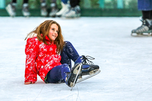 Abby Dennis, 8, shakes off a spill on Jeffersonville's Ice Rink on Friday. Staff Photo By Josh Hicks