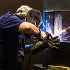 Welder Bill Cline fuses together a large metal frame at Spencer Machine & Tool. Staff Photo By Josh Hicks