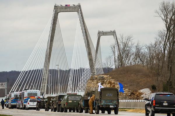 Busses and a military convoy prepare for a trip across the newly named Lewis and Clark Bridge as part of a motorcade in celebration of the bridge opening on Sunday. Staff photo by Tyler Stewart