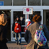 Salvation Army volunteer Danny Black, Jeffersonville, greets shoppers as they make their way into Wal-Mart in Clarksville on Monday. Staff photo by Tyler Stewart