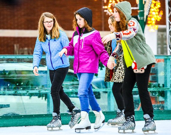 (left to right) Desaree Day, 12, Claire Fletcher, 13, and Zoe Dognaux, 12, hold hands and socialize as they glide across Jeffersonville's Ice Rink on Friday. Staff Photo By Josh Hicks