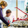 Kilian Colvin, 7, and his grandmother Kelly Colvin check out a large collection of toy fire trucks, dating all the way back to the 1920s, during Snacks with Santa at the Vintage Fire Museum in Jeffersonville on Saturday. Staff Photo By Josh Hicks
