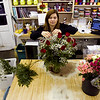 Manager Lara Collett, New Albany, prepares a rose arrangement for a Valentine's Day order at Aebersold Florist in New Albany on Friday morning. Both the Sellersburg and New Albany locations will be open extended hours this weekend, Sat. 8 a.m. to 5 p.m. and Sun. 8 a.m. to 1 p.m., to help manage the large demand surrounding the holiday. Staff photo by Christopher Fryer