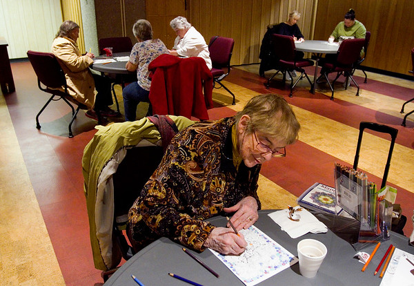 "Janice Molnar, Jeffersonville, uses colored pencils to work on a design during Adult Coloring at the New Albany-Floyd County Public Library in downtown New Albany on Wednesday afternoon. Molnar said the activity is meditative and that she enjoys  ""just relaxing with the movement"" of the page she chose with ""sea like"" swirls in the design. The library activity was started last November, and administrators have had to increase meetings to twice a month due to the popularity. Staff photo by Christopher Fryer"