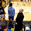 Rev. Adam Ahern shares a laugh with Our Lady of Providence Junior-Senior High School students during halftime at the Class 2A Henryville Sectional tournament earlier this month where the Pioneers' girls varsity team defeated Paoli High School 59-40. Rev. Ahern started serving as Providence's chaplain last fall after being ordained in the Catholic priesthood last June. Staff photo by Christopher Fryer