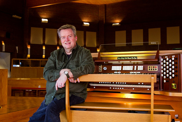 David Lamb, music director of Trinity United Methodist Church, is pictured with the Horace Wesley Cutler Memorial Pipe Organ in the sanctuary of the church in New Albany. Staff photo by Christopher Fryer