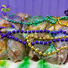 Mardi Gras beads are pictured on a king cake at Sweet Stuff Bakery in downtown New Albany on Monday afternoon. Staff photo by Christopher Fryer