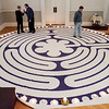 Madonna and Darrell Bensing, left, both of New Albany, and Mike Banman, Little Rock, Ark., navigate a seven-circuit labyrinth made out of cloth in the sanctuary at Centenary United Methodist Church in downtown New Albany on Wednesday morning. The labyrinth, which is intended for prayer and meditation, was placed Fat Tuesday and will be available through the remainder of Lent. Staff photo by Christopher Fryer
