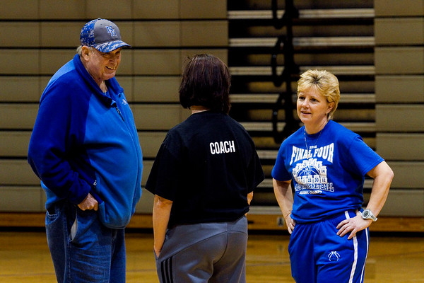 North Harrison assistant coaches Angie Hinton, right, and her husband, Joe, left, speak with the head coach, Missy Voyles, during the Cougars' practice in Ramsey on Wednesday afternoon. Staff photo by Christopher Fryer