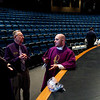 Rev. Adam Ahern, right, discusses national politics with Website Coordinator Ray Day, center, and Campus Minister Leah Kelly prior to Ash Wednesday mass in the auditorium at Our Lady of Providence Junior-Senior High School in Clarksville last week. Staff photo by Christopher Fryer
