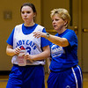 North Harrison assistant coach Angie Hinton, right, speaks with her daughter, sophomore guard Hallie Hinton, during the Cougars' practice in Ramsey on Wednesday afternoon. Staff photo by Christopher Fryer