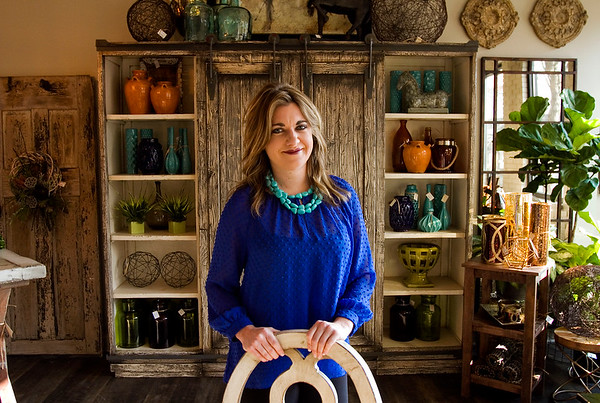 Owner Amanda Book, New Albany, is pictured inside Madhouse, a home decor and gift boutique, which opened for business in downtown New Albany last October. Staff photo by Christopher Fryer