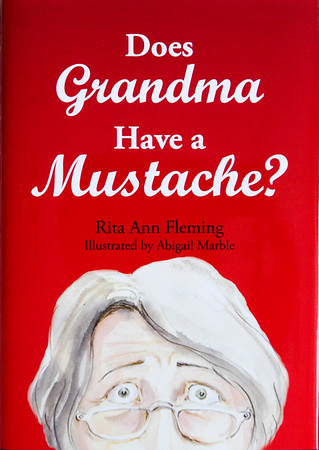 "A copy of ""Does Grandma Have a Mustache?"" is pictured in the office of the author, Dr. Rita Ann Fleming, in downtown Jeffersonville. Staf photo by Christopher Fryer"