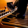 David Lamb, music director of Trinity United Methodist Church, plays the pedal keyboard of the Horace Wesley Cutler Memorial Pipe Organ in the sanctuary of the church in New Albany. Staff photo by Christopher Fryer
